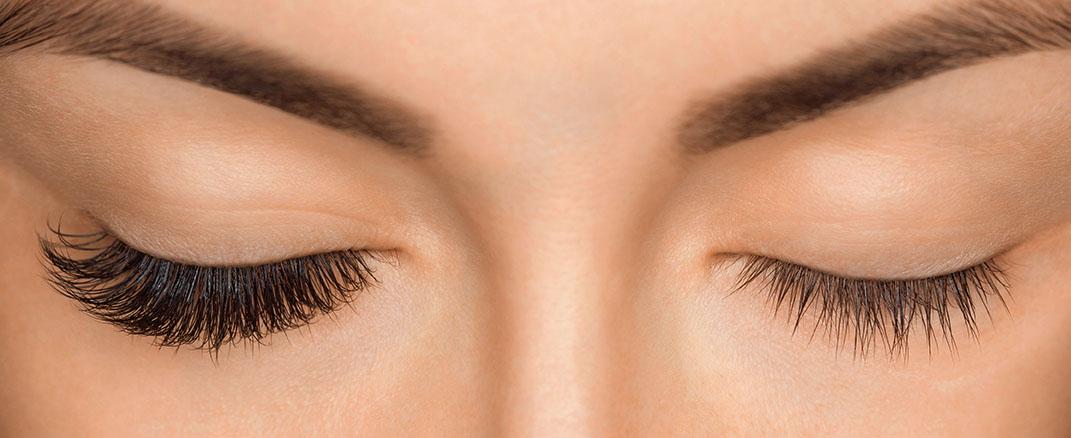 Eyelash removal procedure close up. Beautiful Woman with long la